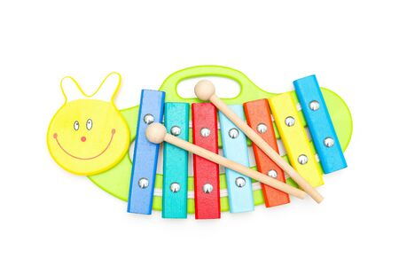 Child wooden xylophone andwooden sticks on a white background. Education concept Stock Photo