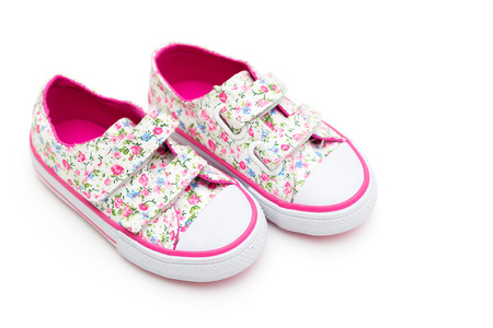Girls shoes in flowers and pink color on a white background girls shoes in flowers and pink color on a white background flat lay stock mightylinksfo