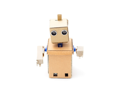Cardboard robot with hands on a white background. Artificial Intelligence
