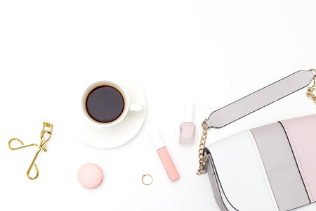 Female accessories and cosmetics on a white background. Copy space