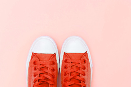 Sneakers mint color on a pink background. Flat lay