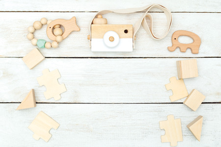 Wooden children toys on wooden background. Copy space Stockfoto