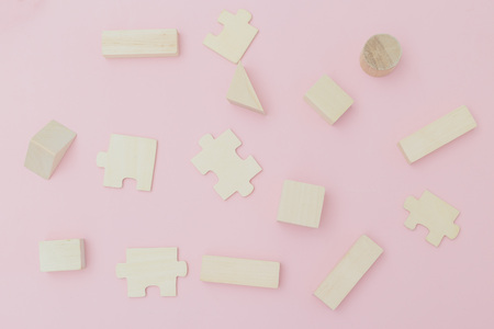 Toys background. Organic wooden toys on pink background