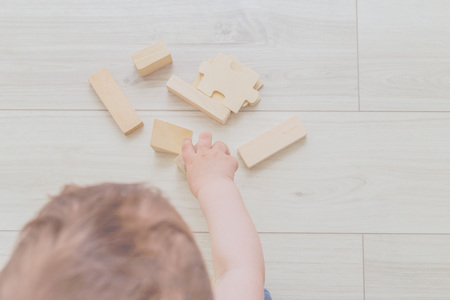 Baby hands and organic wooden toys. Flat lay Banco de Imagens