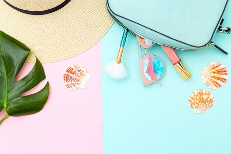 Travel  and beauty feminine accessories on pastels color background. Copy space