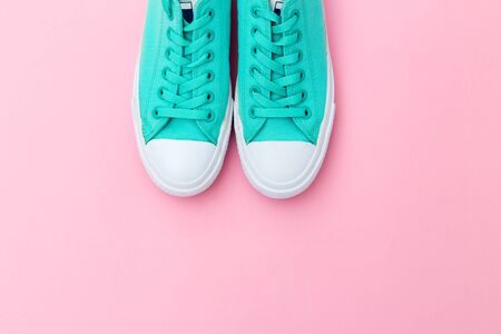 Shoes green color for casual on pink background. Copy space Banco de Imagens
