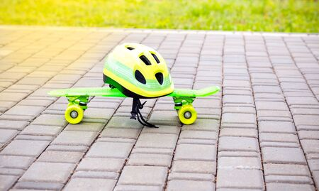 Kids safety. Green helmet and green  skateboard