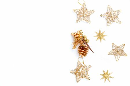 Christmas  gold decorations on white background. Copy space Imagens