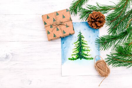 Christmas trees watercolor and hand made gift box. Copy space Imagens