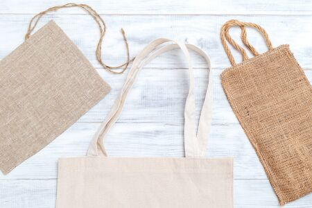 Organic bags on white wooden background. Zero waste 写真素材