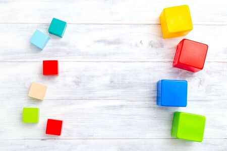 Baby wooden toys. Multicolored cubes