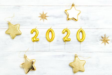 Happy New Year 2020. Symbol from golden number 2020 on white wooden background. 写真素材