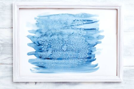 Abstraction paint strokes indigo color on wooden background. Frame 写真素材