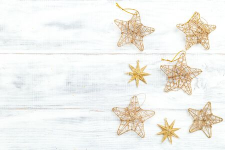Golden stars on white wooden background. Gopy space Imagens