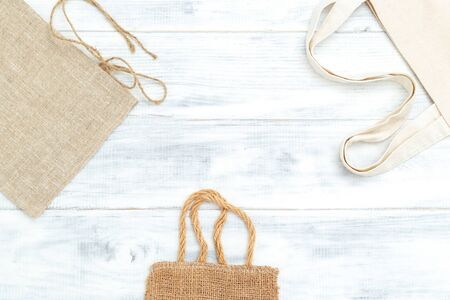 Zero waste. Natural fabrics bags on white wooden background 写真素材