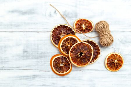 Dried Orange Slices For Christmas Orange Slice Garland on white wooden background. Copy space