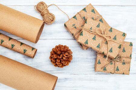Christmas gift box  craft and craft paer on white wooden background. Flat lay 写真素材