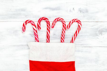 Christmas candy cane on white wooden background. Flat lay