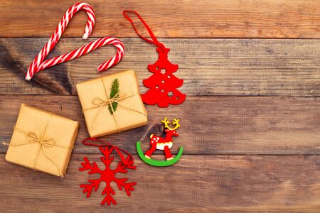 Christmas decorations on brown wooden background. Copy space