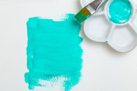 Neon mint color  watercolor with Palette and brush. Watercolor background. White background 写真素材