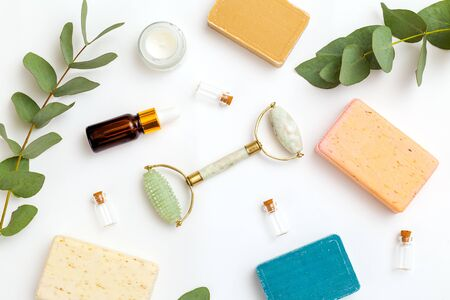 Organic skin care  products and  face roller on white background. Copy space. Apothecary
