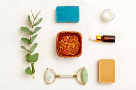 Modern apothecary. dry  marigold herbs and skin care products. Flat lay Imagens