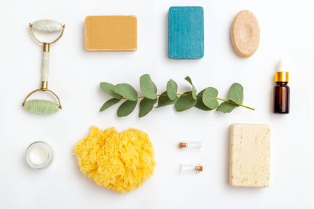 Eucalyptus and natural skin care products on white background.  Flat lay Imagens