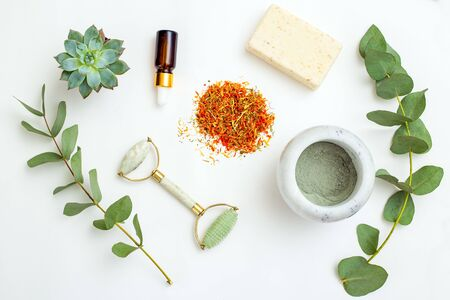 Dried marigold flowers and natural skin care ingredient on white background. Apothecary.