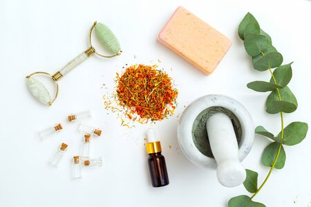 Modern apothecary. eucalyptus and marigold flowers for skin care. Flat lay