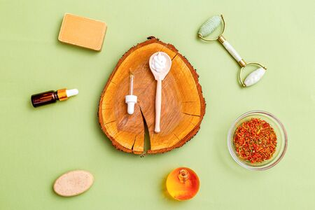 Organic ingredients for skin care on green background. Flat lay. Healthy lifestyle