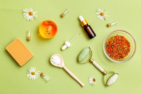 Herbal medicine and  natural skin care products on green background. Modern apothecary