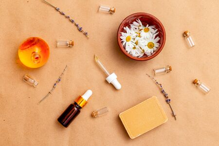 Modern apothecary. Oil,  flower chamomile and serum on craft paper.  Healthy lifestyle Imagens - 134805023