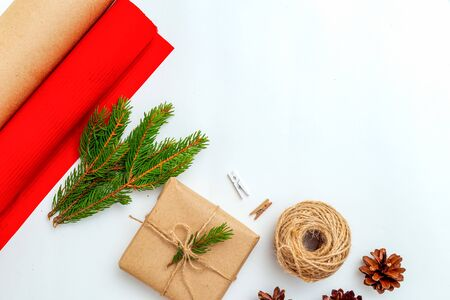 Christmas gift box hand made and  fir branches on white background. Christmas zero waste. Copy space Imagens