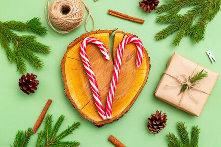 Christmas organic decoration and candy cane on green background. Christmas zero waste.