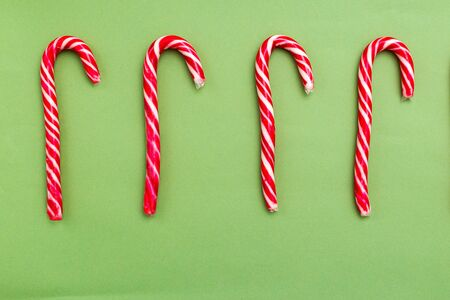 Christmas candy cane on green background. Christmas time Imagens