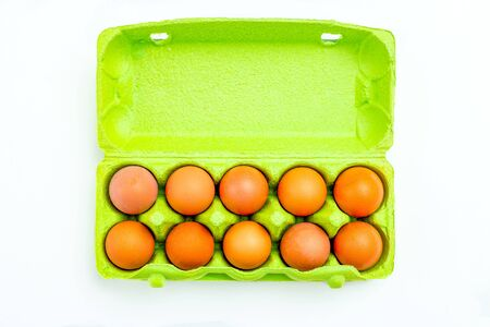 Eggs in green paper packing box on white backgroun. Sustainable lifestyle