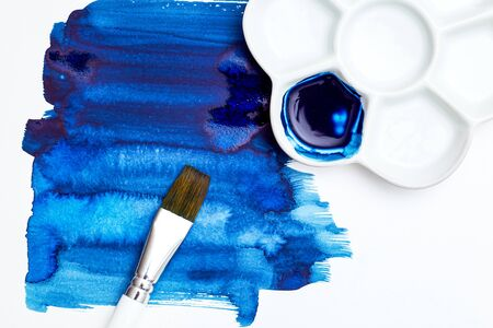 Blue color  and brush Color 2020, flat lay