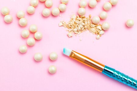 Pink blush balls and makeup brush. Beauty products