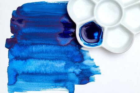 Blue  strokes and palette on white background. Color 2020.  Blue paint strokes