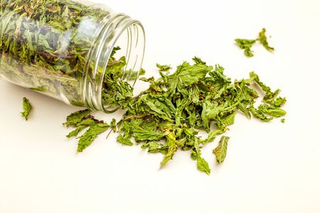 Dry green mint in a glass jar. Healthy lifestyle. Minimalist Imagens