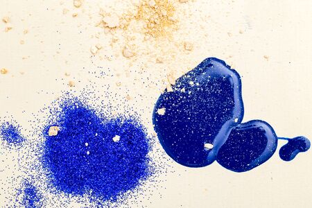 Abstraction fashion background. Drops of blue nail polish, sparkles and powder. Beauty Imagens