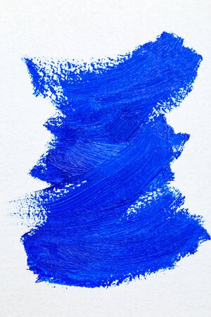Blue color 2020. Oil paint strokes on white background. Art background. Vertical photo