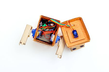 Disassembled robot on a white background. Details View from above. Artificial intelligence Imagens