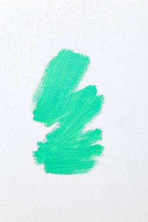 Aqua Menthe color paint oil strokes on white background. Vertical. Color 2020
