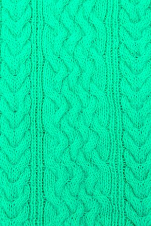 Knitted pattern in green. Aqua Menthe. Color 2020. vertical