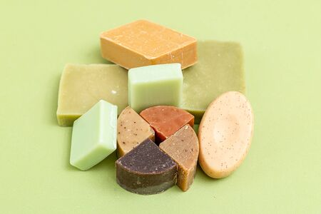 Natural  soap on a green background. Selective focus. Muted shades. still life 스톡 콘텐츠