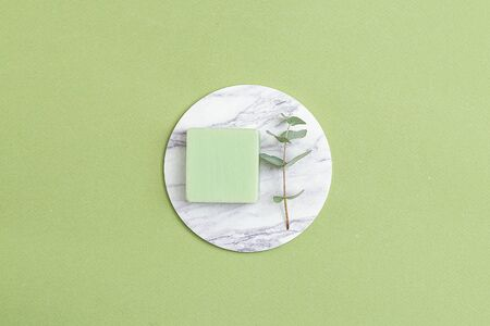 Natural  soap and  eucalyptus on a green background. Minimalism. Flat lay 스톡 콘텐츠