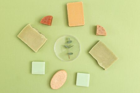 Natural  soap and  eucalyptus on a green background. Organic. Minimalism 스톡 콘텐츠