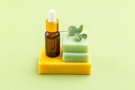 Soap green and yellow color with eucalyptus and serum on green backgriund. Skin care. Minimalism 스톡 콘텐츠 - 149845500