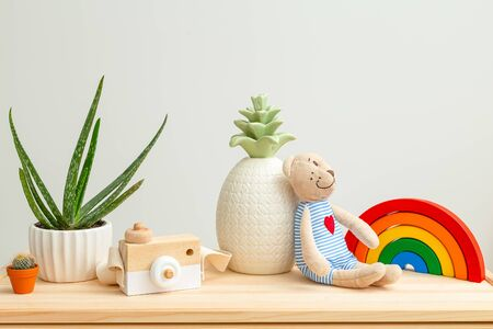 Kids toys and Houseplant. Life style. Plant home decoration Imagens